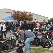 Crowd greets riders at City Cycle Sales in Junction City, KS